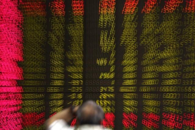 World stock markets mixed after Trump-Kim summit
