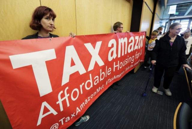 Seattle leaders face raucous debate on Amazon tax rollback