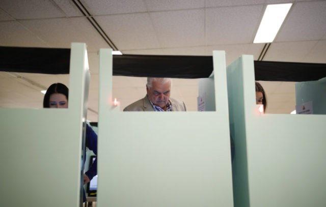 Clark County Commission member and Democratic gubernatorial candidate Steve Sisolak, center, votes in a primary election Tuesday, June 12, 2018, in Las Vegas. Sisolak and Christina Giunchigliani, each hoping to be Nevada's first Democratic governor in two decades. Both candidates have pledged to stand up to Trump and the National …