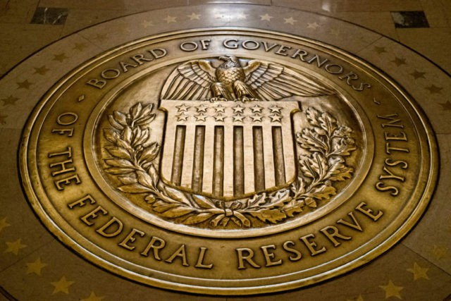 The Latest: Markets steady ahead of Fed rate announcement