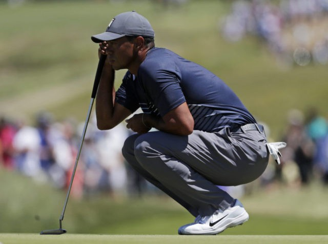 The Latest: Woods benefits from rule on ball moving on green