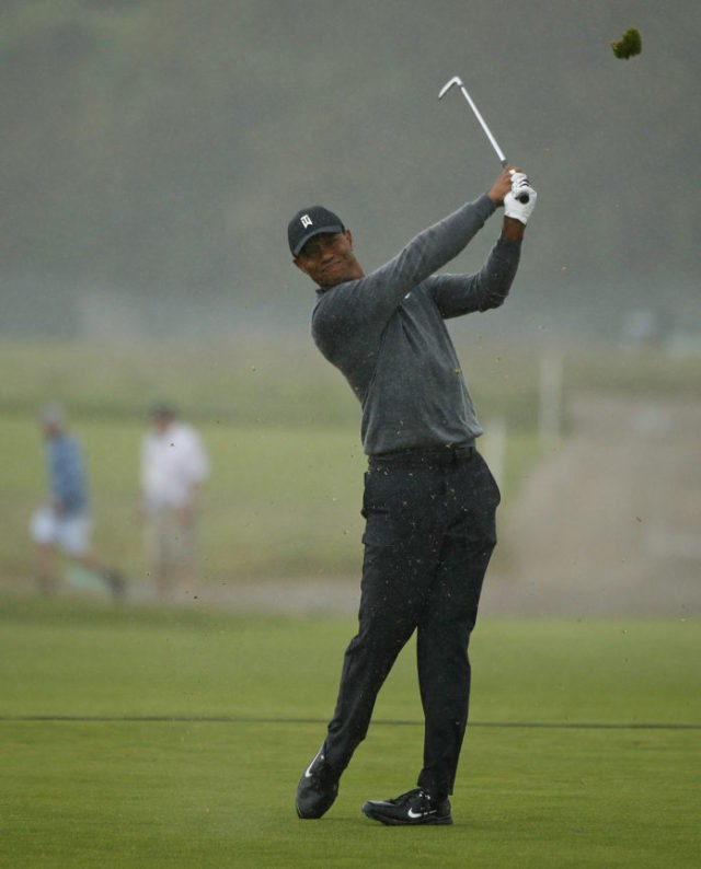 The Latest: Tiger Woods shows grit at end of 2nd round