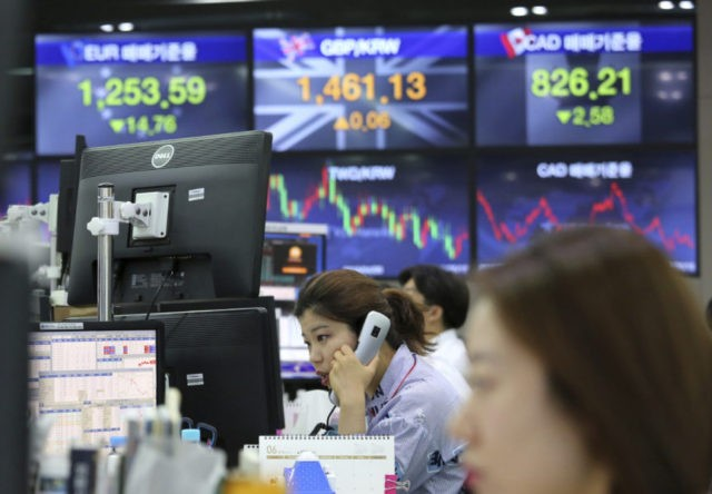 Global stocks mostly lower as US plans tariffs on China