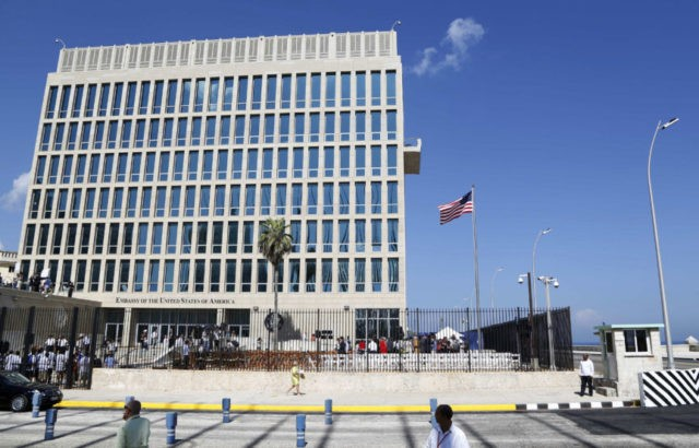 "In this Aug. 14, 2015, file photo, a U.S. flag flies at the U.S. embassy in Havana, Cuba. The United States is renewing calls for the Cuban government to determine the source of ""attacks"" on U.S. diplomats in Cuba that have affected some two dozen people. At a senior-level meeting …"