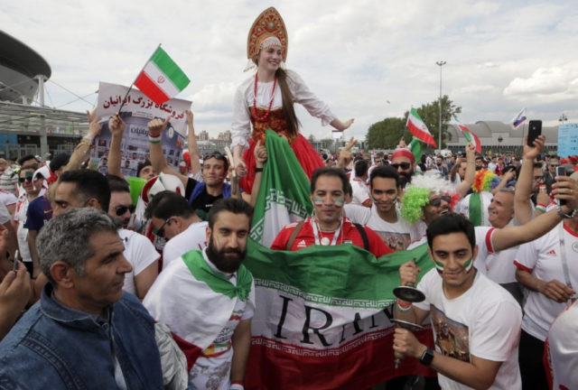 The Latest: FIFA allows Iran banner as 'social appeal'