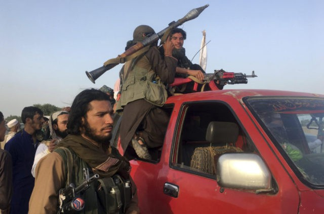 Taliban fighters ride in their vehicle in Surkhroad district of Nangarhar province, east of Kabul, Afghanistan, Saturday, June 16, 2018. A suicide bomber blew himself up in eastern Afghanistan on Saturday as mostly Taliban fighters gathered to celebrate a three-day cease fire marking the Islamic holiday of Eid al-Fitr, killing …