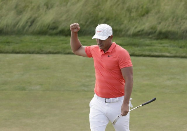 The Latest: Defending champion Koepka leads at turn