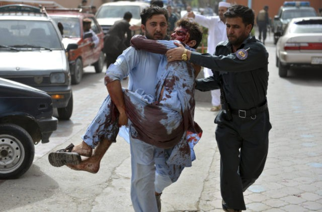 Afghan bomber kills 19, Taliban rejects cease-fire extension