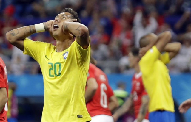 The Latest: Top teams have trouble winning at World Cup