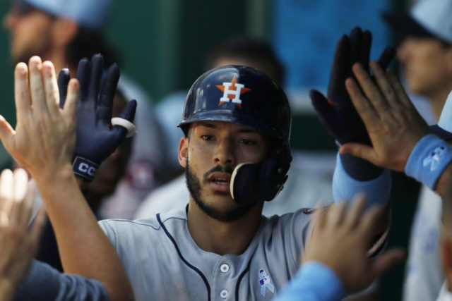 Astros win 11th straight and finish 10-0 trip, beat KC 7-4