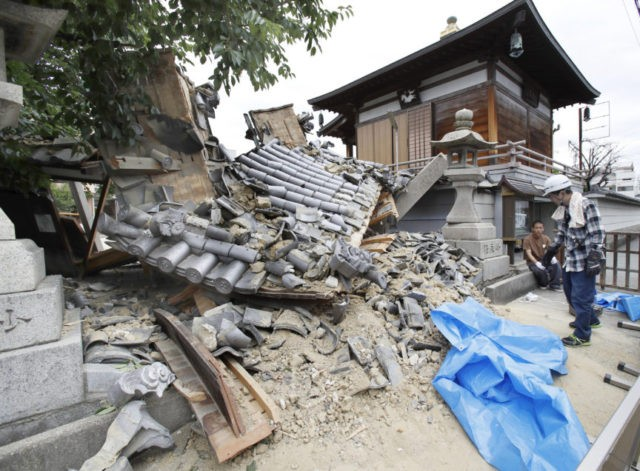 Schoolgirl killed by falling wall as quake strikes Osaka, Japan