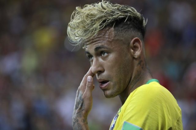 The Latest: Cantona joins in mocking of Neymar's hairdo