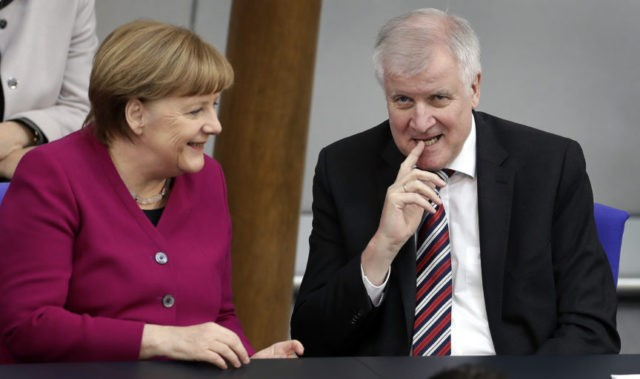 The Latest: Merkel will talk to other countries on migration