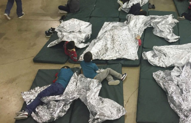 In this photo provided by U.S. Customs and Border Protection, people who've been taken into custody related to cases of illegal entry into the United States, rest in one of the cages at a facility in McAllen, Texas, Sunday, June 17, 2018. (U.S. Customs and Border Protection's Rio Grande Valley …