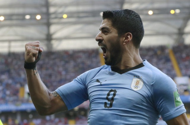 The Latest: Suarez strike has Uruguay up 1-0 at halftime