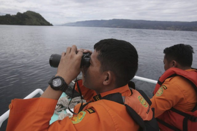 Families plea for bigger search for 192 from Indonesia ferry