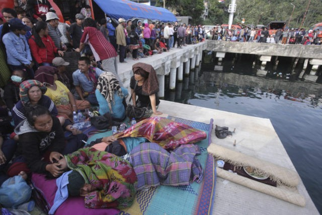 Hundreds wait at Indonesia lake as search for bodies resumes