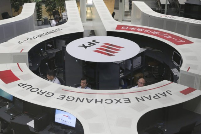 Stocks mostly lower amid caution over US-China tensions