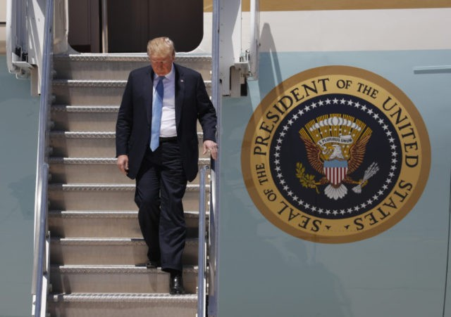 The Latest: Hundreds protest Trump's visit to Nevada