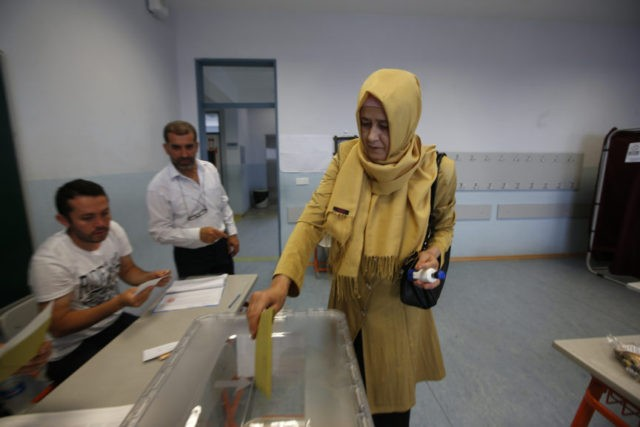 The Latest: Bulk voting seen at Turkish polling station