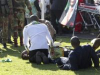 Injured people are attended to as they lay on the ground following an explosion at a Zanu pf rally in Bulawayo, Saturday, June, 23, 2018. An explosion rocked a stadium where Zimbabwe's president was addressing a campaign rally on Saturday, with state media calling it an assassination attempt but saying …