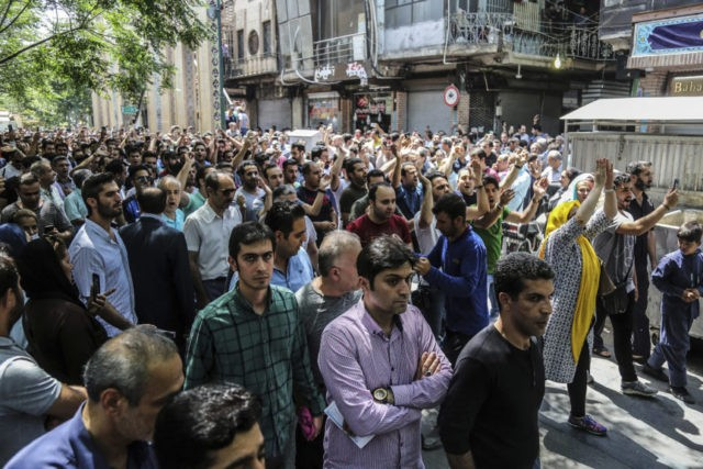 A group of protesters chant slogans at the old grand bazaar in Tehran, Iran, Monday, June 25, 2018. Protesters in the Iranian capital swarmed its historic Grand Bazaar on Monday, news agencies reported, and forced shopkeepers to close their stalls in apparent anger over the Islamic Republic's troubled economy, months …
