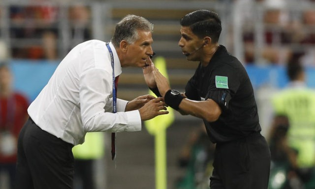 The Latest: Queiroz queries video reviews after Iran's exit