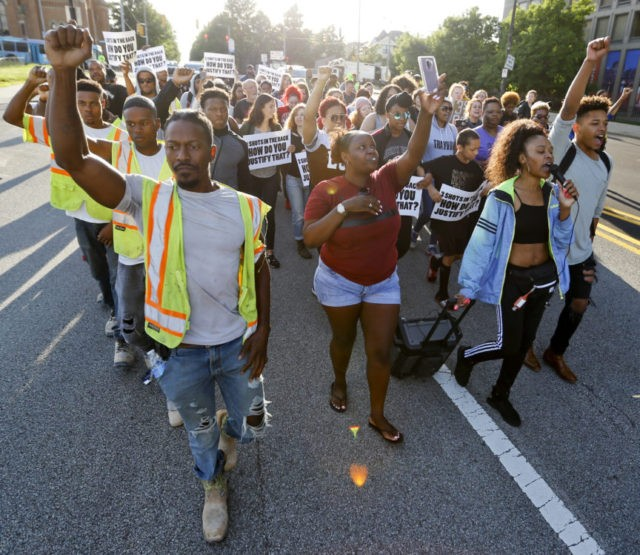 Protesters halt traffic over fatal police shooting of teen