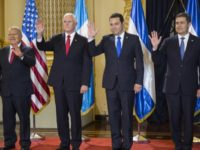 Leaders, from left, El Salvador's President Salvador Sanchez, U.S. Vice President Mike Pence, Guatemala's President Jimmy Morales and Honduras' President Juan Orlando Hernandez wave to the press during a photo opportunity, prior to their meeting on immigration issues at the National Palace in Guatemala City, Thursday, June 28, 2018. (AP …