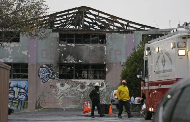 Key figure charged in fatal warehouse fire nears plea deal