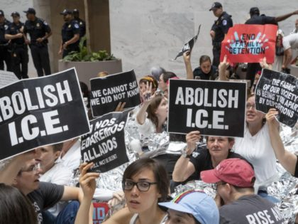 Hundreds of activists protest the Trump administration's approach to illegal border crossings and separation of children from immigrant parents, in the Hart Senate Office Building on Capitol Hill in Washington, Thursday, June 28, 2018. Several prominent Democrats who are mulling a bid for the White House in 2020 sought to …