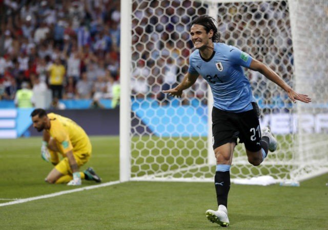 The Latest: Cavani header gives Uruguay 1-0 lead v Portugal