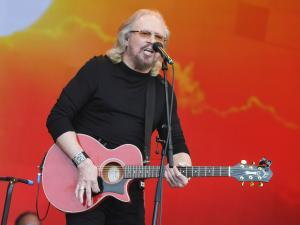 Barry Gibb of the Bee Gees is knighted by Prince Charles