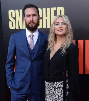Kate Hudson cozies up to Danny Fujikawa during babymoon