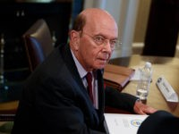 Secretary of Commerce Wilbur Ross listens during a meeting between President Donald Trump and steel and aluminum executives in the Cabinet Room of the White House, Thursday, March 1, 2018, in Washington. (AP Photo/Evan Vucci)
