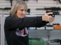 *** EXCLUSIVE - VIDEO AVAILABLE *** ORLANDO, FLORIDA - DECEMBER 11: NRA certified instructor and founder of the Florida faction of Pink Pistols Jo Martin pointing a gun, on December 11, 2016 in Orlando, Florida. A gun group are encouraging members of the gay community to take up arms after …