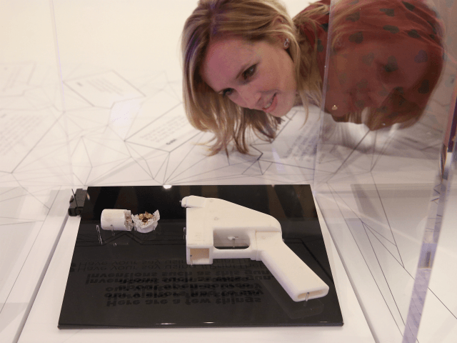 A woman admires a 3D printed handgun which was created and fired by Finnish journalist Ville Vaarne and which is displayed in the exhibition '3D: printing the future' in the Science Museum on October 8, 2013 in London, England. The exhibition, which opens to the public tomorrow, features over 600 …