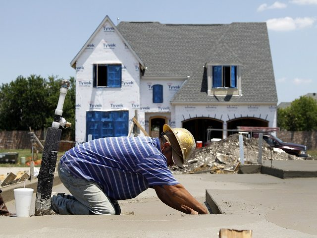 A Hawkins-Welwood Homes employee applies the final touches to a foundation as construction on a luxury townhome is shown at rear Wednesday, May 16, 2012, in Plano, Texas. A measure of future U.S. economic activity fell in April, the first setback after six months of increases, reflecting weakness in housing …