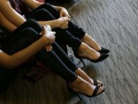 FILE - In this Tuesday, Jan. 12, 2016, file photo unidentified members of the industry group Club Owners Against Sex Trafficking sit for a talk given by a U.S. Department of Homeland Security agent teaching owners of strip clubs and strippers how to spot sex traffickers, at the Burbank Community …