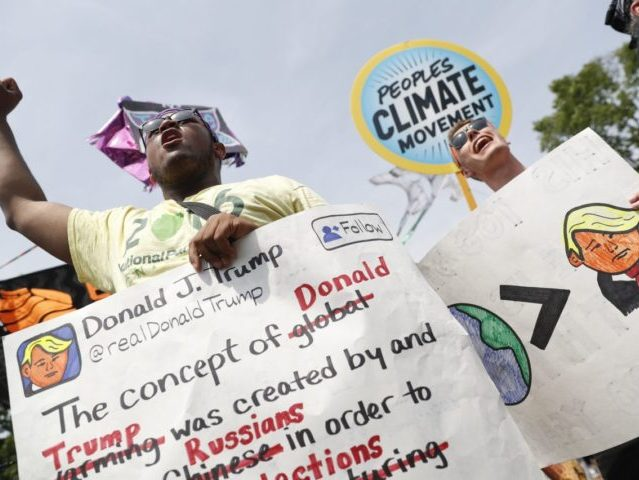 A pair of participants chant in front of the White House in Washington, Saturday, April 29, 2017, during a demonstration and march. Thousands of people gathered across the country to march in protest of President Donald Trump's environmental policies, which have included rolling back restrictions on mining, oil drilling and …