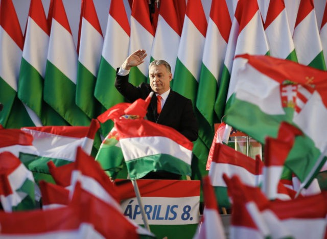 Prime Minister Viktor Orban's waves during the final electoral rally of his Fidesz party in Szekesfehervar, Hungary, Friday, April 6, 2018. Hungarians will vote Sunday in parliamentary elections, choosing 199 lawmakers and polls expect Prime Minister Viktor Orban to win a third consecutive term and his fourth overall since 1998.(AP …