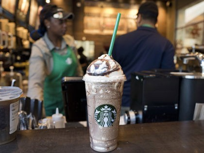 A Venti Mocha Frappuccino is displayed at a Starbucks, Wednesday, June 20, 2018, in New York. The 24 fluid ounces drink has 520 calories, according to Starbucks. Starbucks says sales for its frozen coffee drink are down, and is blaming concerns about sugar and calories. (AP Photo/Mark Lennihan)