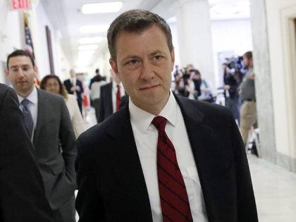 Peter Strzok, center, the FBI agent facing criticism following a series of anti-Trump text messages, walks to gives a deposition before the House Judiciary Committee on Capitol Hill in Washington, Wednesday, June 27, 2018. (AP Photo/Alex Brandon)