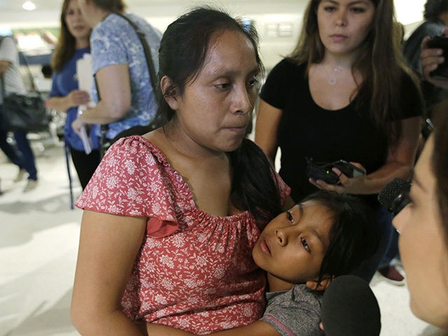 Buena Ventura Martin-Godinez, left, hugs her daughter Janne after being reunited at Miami International Airport, Sunday, July 1, 2018, in Miami. Martin crossed the border into the United States from Mexico in May with her son, fleeing violence in Guatemala. Her husband crossed two weeks later with their 7-year-old daughter …