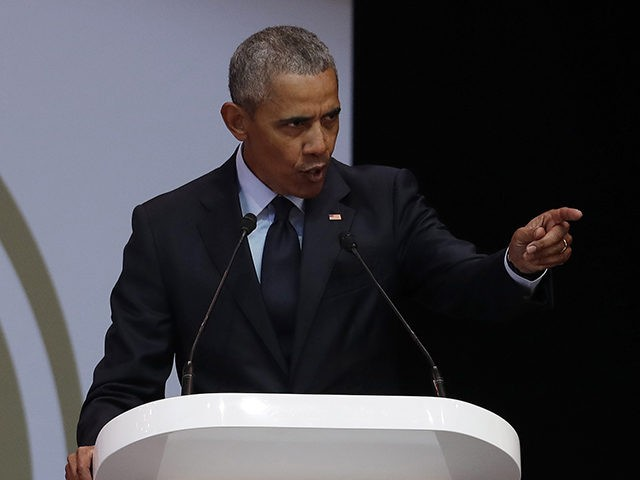Former U.S. President Barack Obama, left, delivers his speech at the 16th Annual Nelson Mandela Lecture at the Wanderers Stadium in Johannesburg, South Africa, Tuesday, July 17, 2018. In his highest-profile speech since leaving office, Obama urged people around the world to respect human rights and other values under threat …