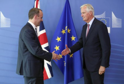 Britain's newly appointed chief Brexit negotiator Dominic Raab, left, is welcomed by EU's chief Brexit negotiator Michel Barnier ahead of a meeting at the European Commission in Brussels, Thursday, July 19, 2018. Britain's chief Brexit negotiator David Davis resigned less than two weeks ago and his successor Raab met his …