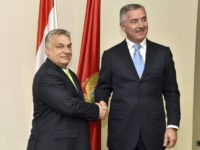 Montenegro President Milo Djukanovic, right, shakes hands with Hungary's Prime Minister Viktor Orban in Montenegro's capital Podgorica, Monday, July 23, 2018. Orban arrived on a two-day visit to Montenegro. (AP Photo/Risto Bozovic)