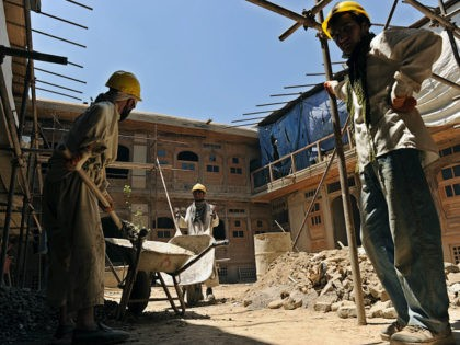 Afghan construction workers restore a traditional courtyard house in Kabul on June 30, 2010, with the support of the Afghan government and the Turquoise Mountain Foundation. The area, called Murad Khani, was on the frontline of fighting during the Afghan civil war of the 1980s, and became a rubbish tip …