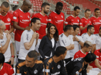 Alona Barkat, the owner of the soccer team Hapoel Beersheba, is seen among players during an interview at Turner Stadium in Beersheba on May 8, 2018. (AFP PHOTO / MENAHEM KAHANA)
