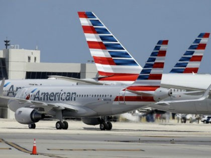 FILE - In this Wednesday, May 27, 2015, file photo, an American Airlines jet taxis to the gate at Miami International Airport, in Miami. The NAACP is warning African-Americans that if they fly on American Airlines they could be subject to discrimination or even unsafe conditions. American said Wednesday, Oct. …